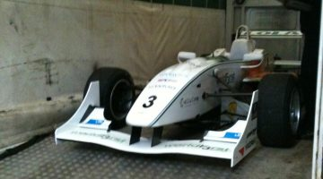 Green bio racing car in transit
