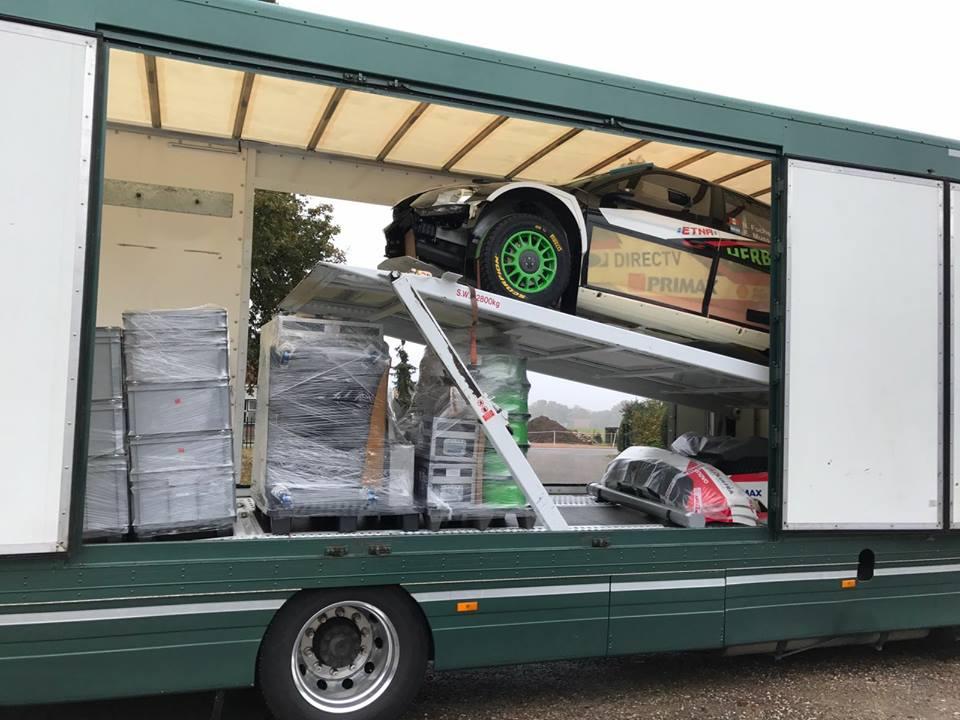 Motorsport car loaded onto transporter